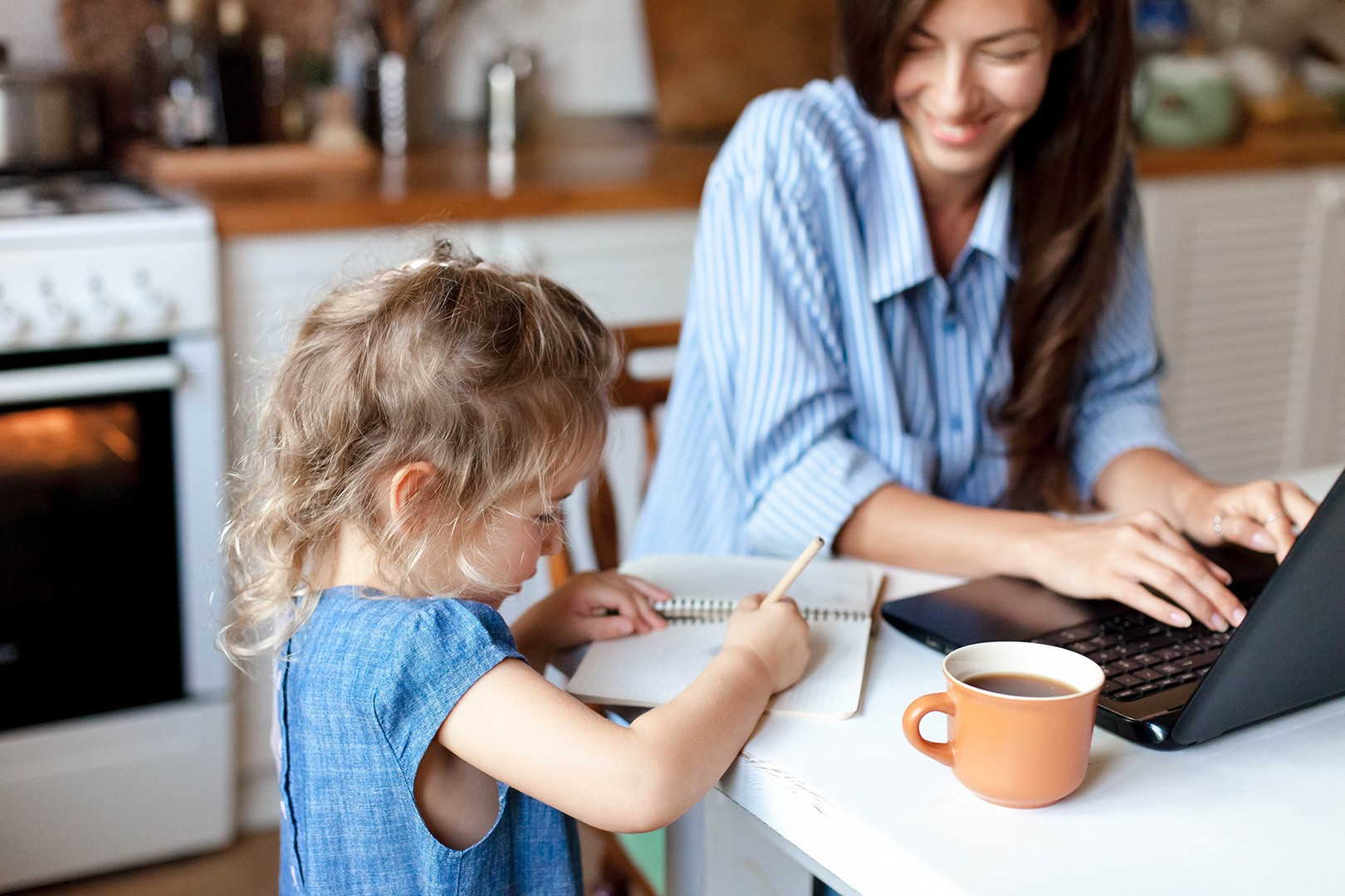 mother-teaching-child-homeschooling-kitchentable